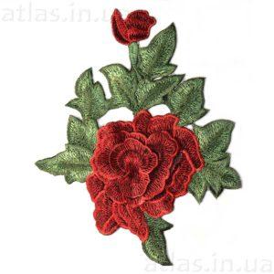 красная роза два бутона на сетке